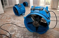 Large Fans Drying Previously Flooded Home