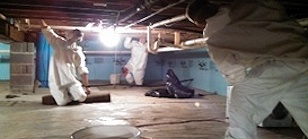 Technicians perform mold remediation in a crawl space